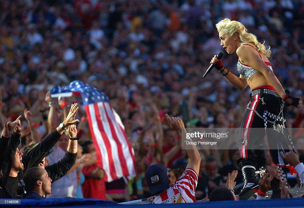 Singer Gwen Stefani and No Doubt perform during half-time of Super Bowl XXXVII between the Tampa Bay Buccaneers and the Oakland Raiders on January 26, 2003 at Qualcomm Stadium in San Diego, California.