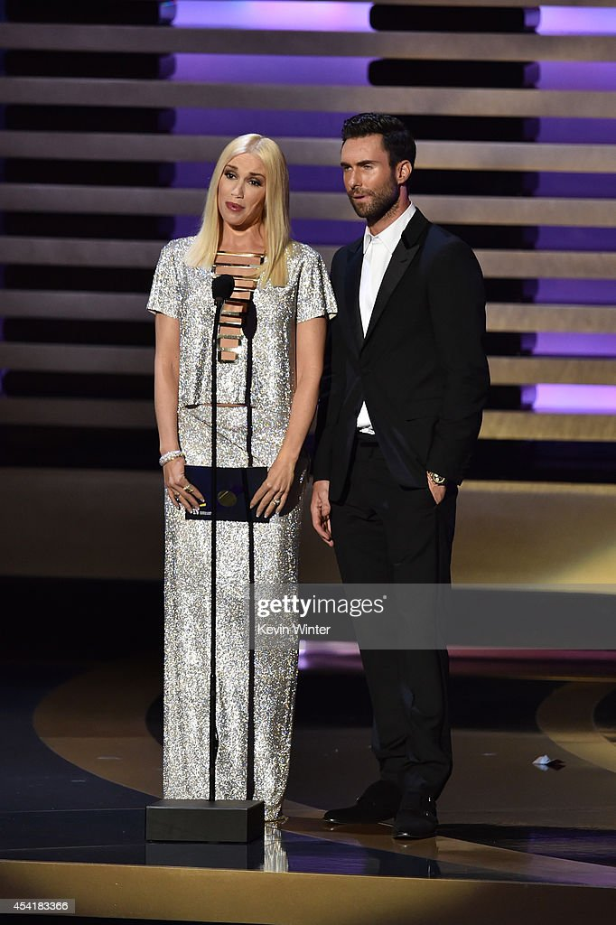 Singer Gwen Stefani and singer/TV personality Adam Levine speak onstage at the 66th Annual Primetime Emmy Awards held at Nokia Theatre L.A. Live on August 25, 2014 in Los Angeles, California.