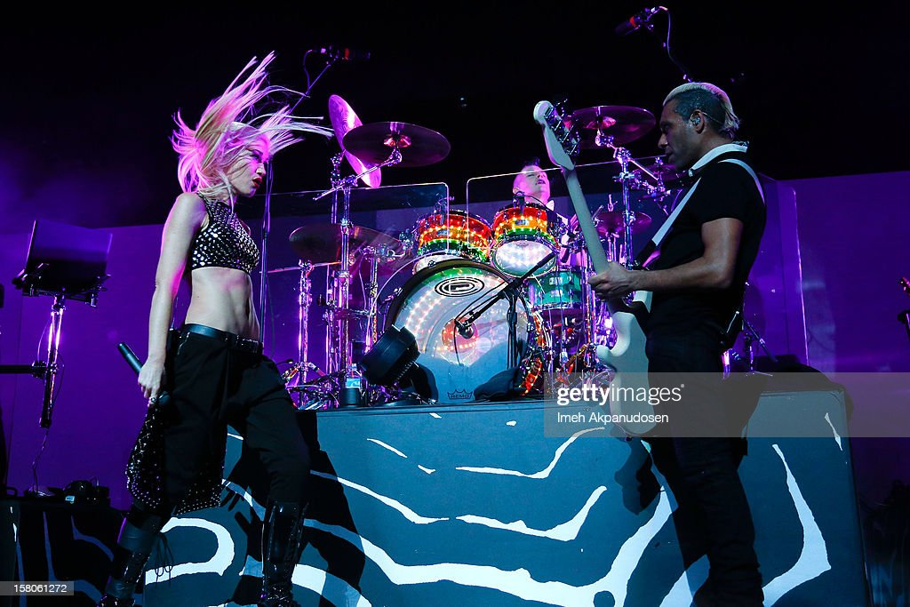 Singer Gwen Stefani, Drummer Adrian Young, and bassist Tony Kanal of No Doubt perform onstage at the 23rd Annual KROQ Almost Acoustic Christmas at Gibson Amphitheatre on December 9, 2012 in Universal City, California.