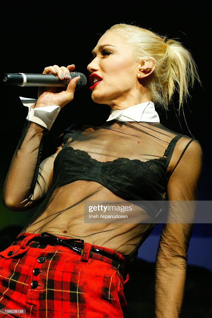 Singer Gwen Stefani makes a surprise appearance, performing onstage with Bush at the 23rd Annual KROQ Almost Acoustic Christmas at Gibson Amphitheatre on December 8, 2012 in Universal City, California.