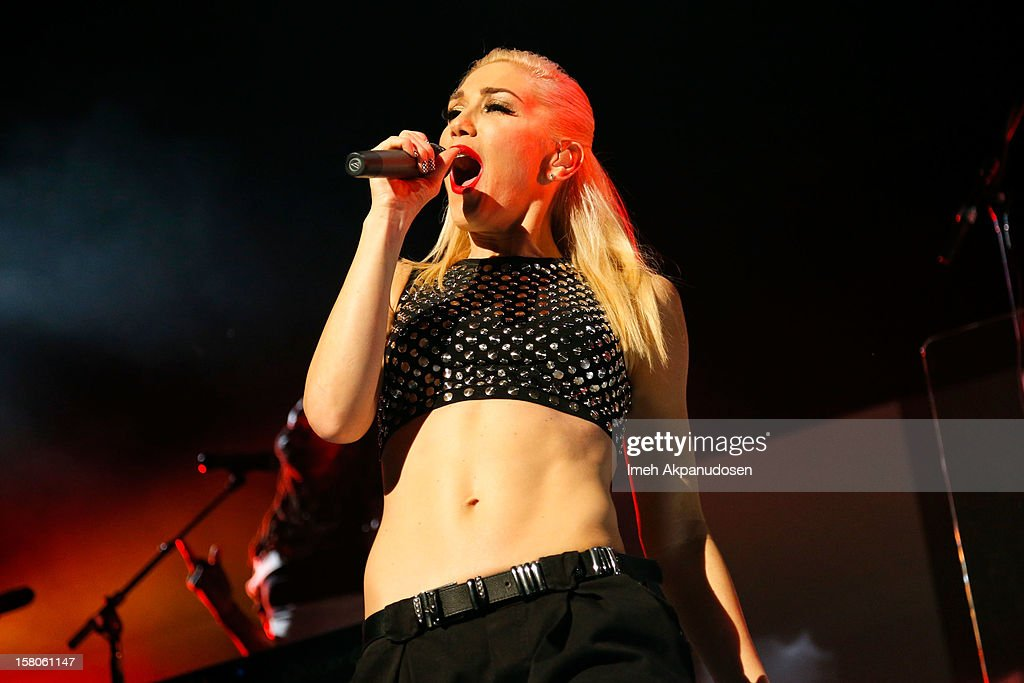 Singer <a gi-track='captionPersonalityLinkClicked' href=/galleries/search?phrase=Gwen+Stefani&family=editorial&specificpeople=156423 ng-click='$event.stopPropagation()'>Gwen Stefani</a> of No Doubt performs onstage at the 23rd Annual KROQ Almost Acoustic Christmas at Gibson Amphitheatre on December 9, 2012 in Universal City, California.
