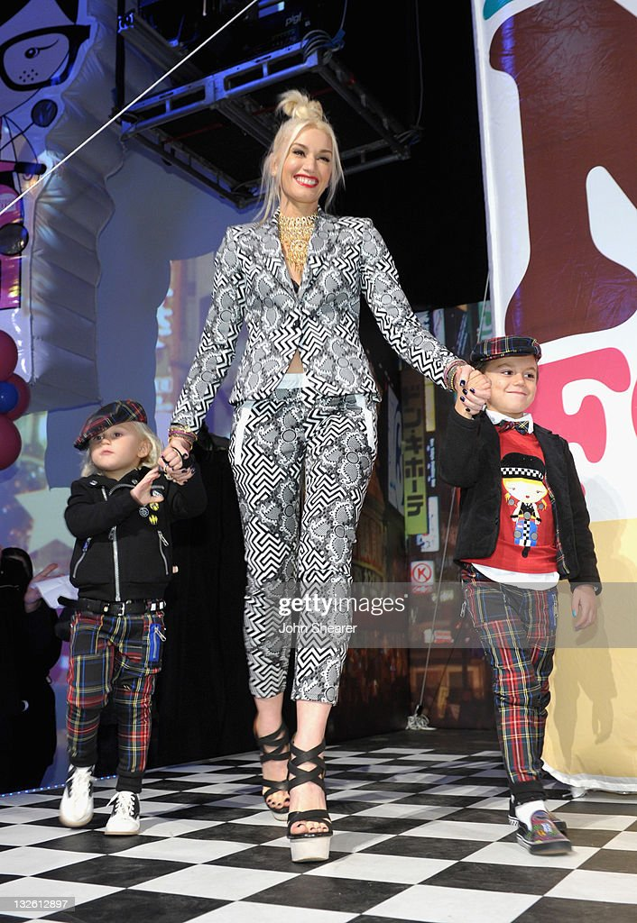 Singer <a gi-track='captionPersonalityLinkClicked' href=/galleries/search?phrase=Gwen+Stefani&family=editorial&specificpeople=156423 ng-click='$event.stopPropagation()'>Gwen Stefani</a> with sons <a gi-track='captionPersonalityLinkClicked' href=/galleries/search?phrase=Zuma+Rossdale&family=editorial&specificpeople=5500594 ng-click='$event.stopPropagation()'>Zuma Rossdale</a> (L) and <a gi-track='captionPersonalityLinkClicked' href=/galleries/search?phrase=Kingston+Rossdale&family=editorial&specificpeople=4484338 ng-click='$event.stopPropagation()'>Kingston Rossdale</a> (R) attend <a gi-track='captionPersonalityLinkClicked' href=/galleries/search?phrase=Gwen+Stefani&family=editorial&specificpeople=156423 ng-click='$event.stopPropagation()'>Gwen Stefani</a>'s launch of her Harajuku Mini for Target Collection at Jim Henson Studios on November 12, 2011 in Los Angeles, California.