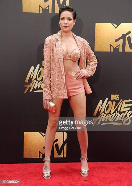 Singer Halsey arrives at the 2016 MTV Movie Awards at Warner Bros Studios on April 9 2016 in Burbank California