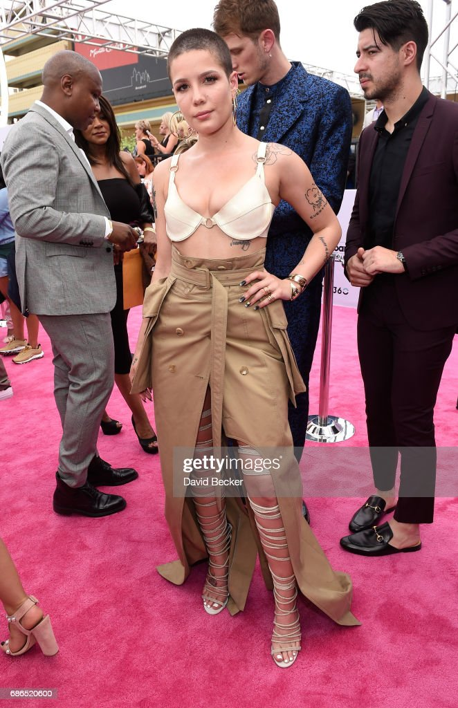Singer Halsey poses at SiriusXM's 'Hits 1 in Hollywood' red carpet broadcast on SiriusXM's SiriusXM Hits 1 channel before the Billboard Music Awards at the T-Mobile Arena on May 21, 2017 in Las Vegas, Nevada.
