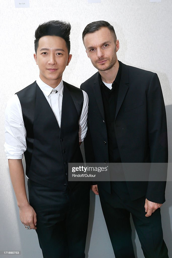 Singer <a gi-track='captionPersonalityLinkClicked' href=/galleries/search?phrase=Han+Geng&family=editorial&specificpeople=5862188 ng-click='$event.stopPropagation()'>Han Geng</a> and Fashion designer Kris Van Assche backstage after Dior Homme Menswear Spring/Summer 2014 Show as part of the Paris Fashion Week on June 29, 2013 in Paris, France.
