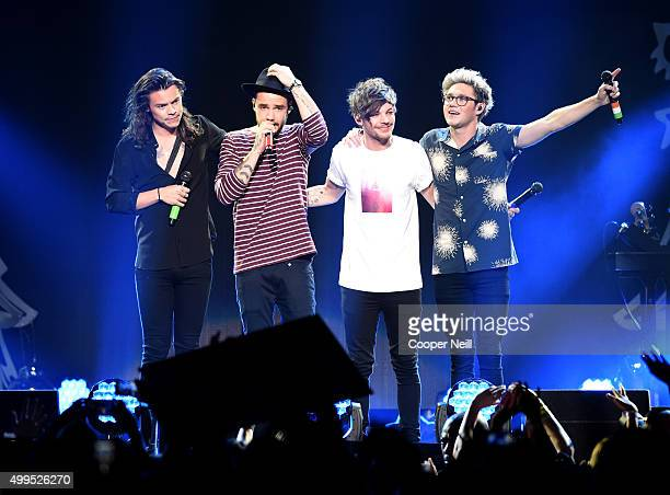 Singer Harry Styles Liam Payne Louis Tomlinson and Niall Horan of One Direction perform onstage during 1061 KISS FM's Jingle Ball 2015 presented by...