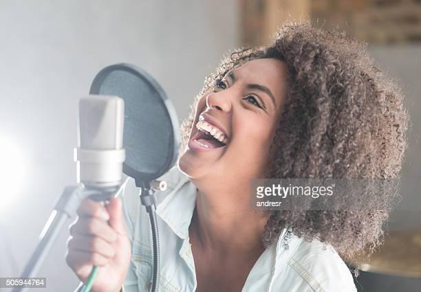 Singer having fun at a recording studio
