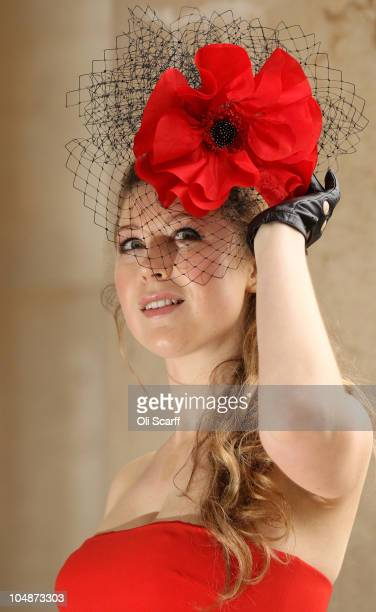 Singer Hayley Westenra poses for photographs wearing a poppy hat to help launch the official album of the 2010 Poppy Appeal at the Imperial War...
