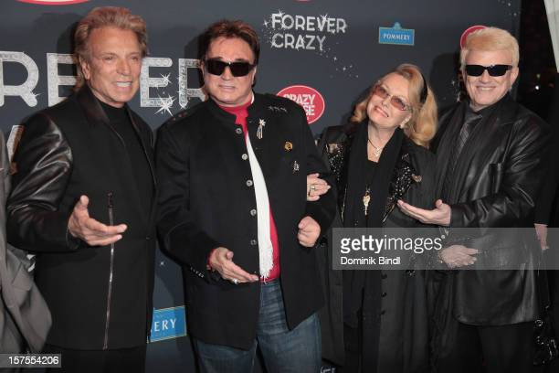 Singer Heino attend with his wife Hannelore artists Roy and Siegfried the 'Forever Crazy' show at Postpalast on December 4 2012 in Munich Germany