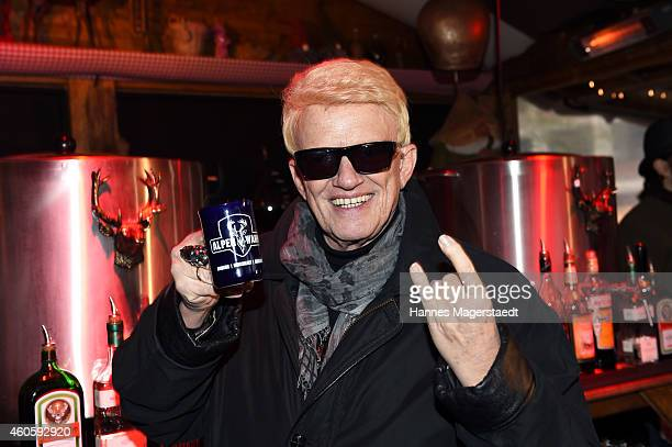 Singer Heino serves mulled wine for charity 'Ein Herz fuer Kinder' at Alpenwahn near by the Viktualienmarkt on December 17 2014 in Munich Germany