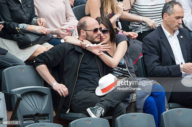 Singer Helena Noguerra and her companion attend the Roland Garros French Tennis Open 2014 on Day 9 at Roland Garros on June 2 2014 in Paris France
