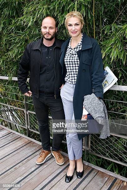 Singer Helena Noguerra and her companion Fabrice Du Welz attend the 2016 French Tennis Open Day Three at Roland Garros on May 24 2016 in Paris France
