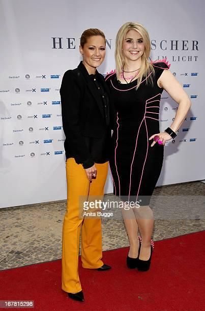 Singer Helene Fischer and Beatrice Egli attend the 'Helene Fischer Allein im Licht' premiere at Babylon on April 30 2013 in Berlin Germany