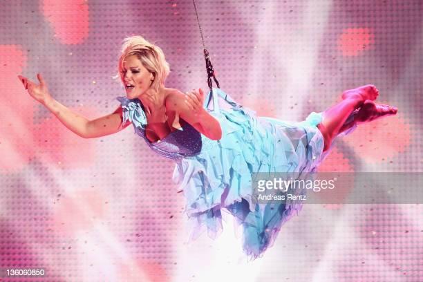 Singer Helene Fischer performs onstage during the 'Die Helene Fischer Show Ein Traumhafter Abend mit vielen Stars' at Velodrom on December 21 2011 in...