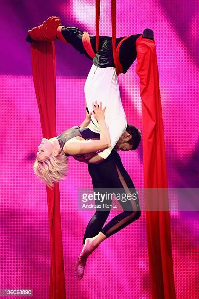 Singer Helene Fischer performs together with artist Nick Beyeler during the 'Die Helene Fischer Show Ein Traumhafter Abend mit vielen Stars' at...