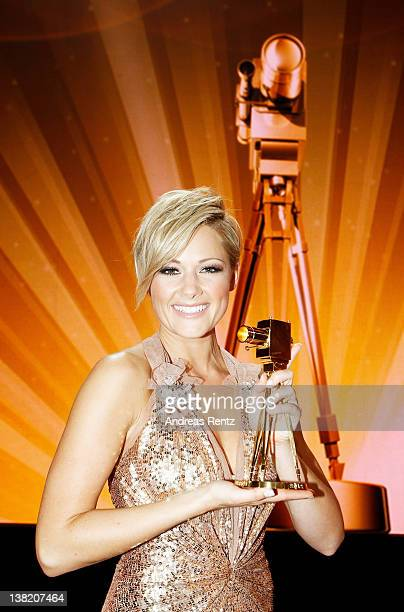 Singer Helene Fischer poses with her Goldene Kamera Best Music National award during the 47th Golden Camera Awards at the Axel Springer Haus on...