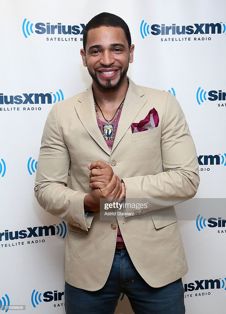 Singer <a gi-track='captionPersonalityLinkClicked' href=/galleries/search?phrase=Henry+Santos&family=editorial&specificpeople=713976 ng-click='$event.stopPropagation()'>Henry Santos</a> visits the SiriusXM Studios on June 12, 2013 in New York City.