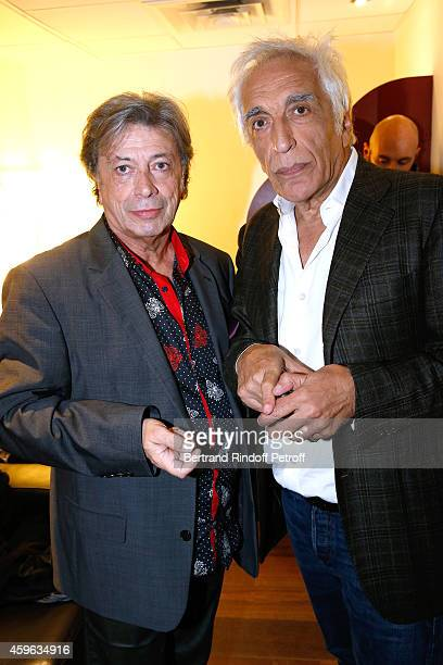 Singer Herve Vilard and actor Gerard Darmon attend the 'Vivement Dimanche' French TV Show at Pavillon Gabriel on November 26 2014 in Paris France