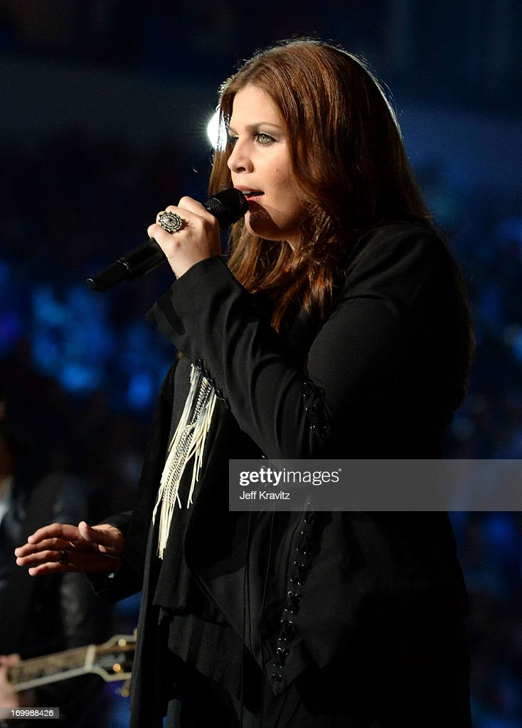 Singer Hillary Scott of Lady Antebellum performs onstage at the 2013 CMT Music Awards at the Bridgestone Arena on June 5, 2013 in Nashville, Tennessee.