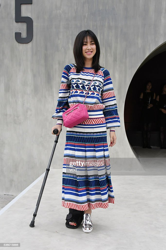 Singer, hostess and actress Zhu Zhu arrives at the red carpet of a press conference of Chanel's 'Paris in Rome 2015/16' Metiers d'Art Show on May 31, 2016 in Beijing, China.
