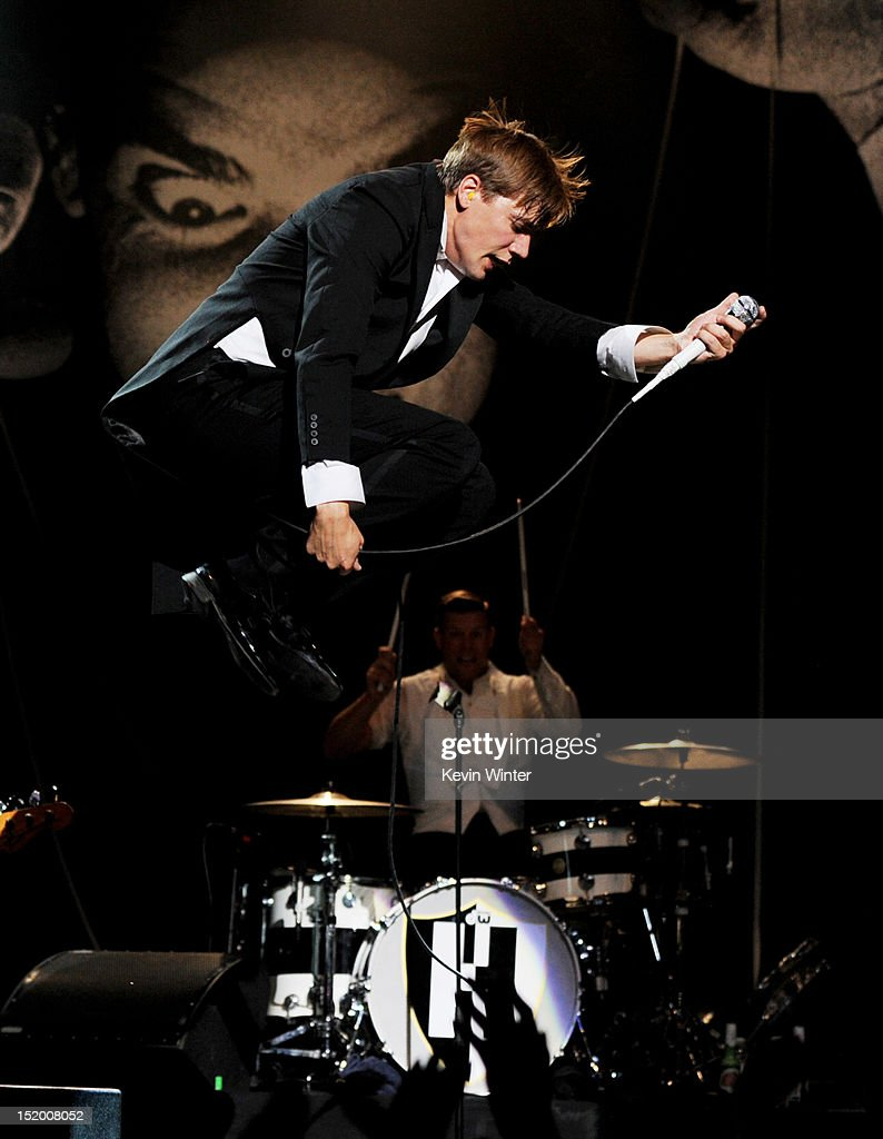 Singer Howlin' Pelle Almqvist (top) and musician Chris Dangerous of The Hives perform at the Wiltern Theater on September 14, 2012 in Los Angeles, California.