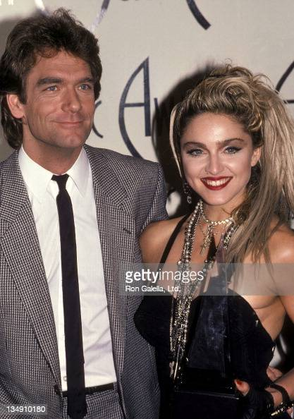Singer Huey Lewis and singer Madonna attend the 12th Annual American Music Awards on January 28 1985 at the Shrine Auditorium in Los Angeles...
