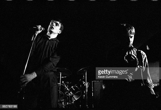 Singer Ian Curtis and bassist Peter Hook performing with English rock group Joy Division at the Russell Club also known as The Factory Manchester 1979