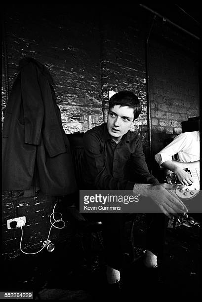 Singer Ian Curtis of rock group Joy Division at TJ Davidson's rehearsal room Little Peter Street Manchester 19th August 1979 On the right is...