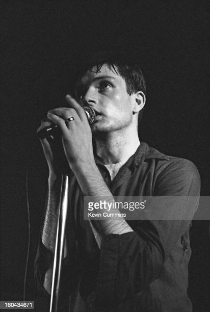 Singer Ian Curtis performing with English rock group Joy Division at the Russell Club also known as The Factory Manchester 13th July 1979