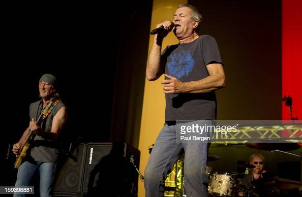 Singer Ian Gillan and bassist Roger Glover and drummer Ian Paice of hard rock band Deep Purple perform on stage at the Heineken Music Hall HMH...
