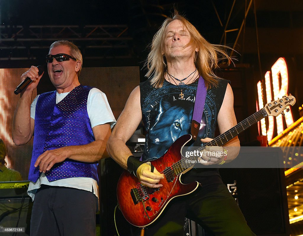Singer Ian Gillan (L) and guitarist Steve Morse of Deep Purple perform at the Fremont Street Experience on August 15, 2014 in Las Vegas Nevada.
