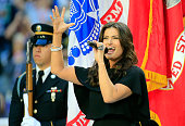 Singer Idina Menzel sings the national anthem prior to Super Bowl XLIX between the New England Patriots and the Seattle Seahawks at University of...