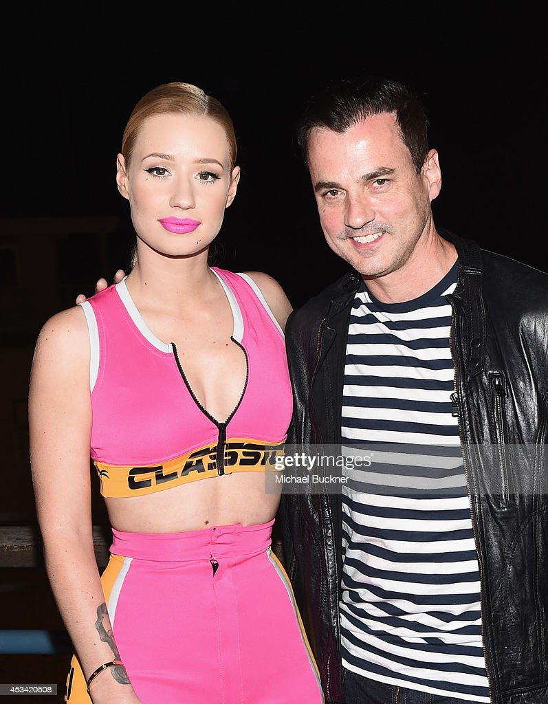 Singer <a gi-track='captionPersonalityLinkClicked' href=/galleries/search?phrase=Iggy+Azalea&family=editorial&specificpeople=8558263 ng-click='$event.stopPropagation()'>Iggy Azalea</a> and Pandora VP Tommy Page attend Pandora Presents on the Santa Monica Pier on August 9, 2014 in Santa Monica, California.
