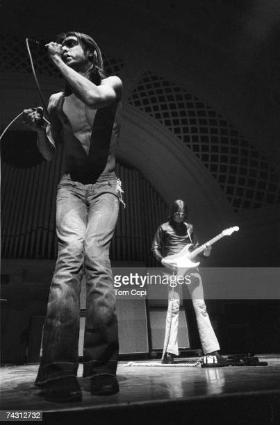 Singer Iggy Pop and guitarist Ron Asheton of the punk band 'The Stooges' perform onstage in 1970 in Ann Arbor Michigan