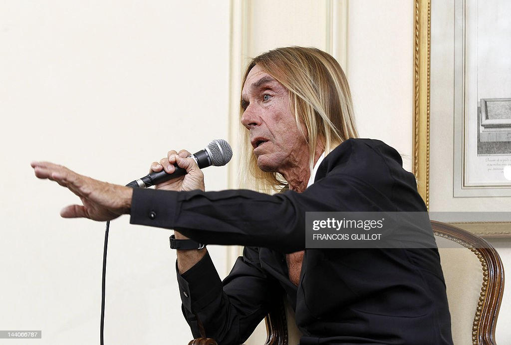 US singer Iggy Pop gives a press conference to present his new album 'Après', on May 9, 2012 in Paris. 'Après' ('After' in French) is Iggy Pop's 16th record, with covers of international and French standards (such as Frank Sinatra, The Beatles, Edith Piaf, Serge Gainsbourg, Georges Brassens, Henri Salvador), exclusively on sale on the French online retailer website vente-privee.com, specialising in selling brand overstock and organizing events-based sales. AFP PHOTO FRANCOIS GUILLOT