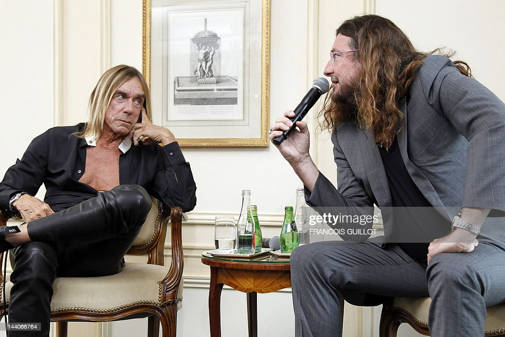 US singer Iggy Pop (L) listens to CEO of vente-privee.com Jacques-Antoine Granjon during a press conference to present his new album 'Après', on May 9, 2012 in Paris. 'Après' ('After' in French) is Iggy Pop's 16th record, with covers of international and French standards (by singers such as Frank Sinatra, The Beatles, Edith Piaf, Serge Gainsbourg, Georges Brassens, Henri Salvador), exclusively on sale on the French online retailer website vente-privee.com, specialising in selling brand overstock and organizing events-based sales.