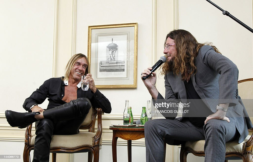 US singer Iggy Pop (L) listens to CEO of vente-privee.com Jacques-Antoine Granjon during a press conference to present his new album 'Après', on May 9, 2012 in Paris. 'Après' ('After' in French) is Iggy Pop's 16th record, with covers of international and French standards (by singers such as Frank Sinatra, The Beatles, Edith Piaf, Serge Gainsbourg, Georges Brassens, Henri Salvador), exclusively on sale on the French online retailer website vente-privee.com, specialising in selling brand overstock and organizing events-based sales. AFP PHOTO FRANCOIS GUILLOT