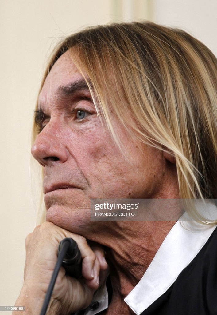 US singer Iggy Pop looks on as he gives a press conference to present his new album 'Après', on May 9, 2012 in Paris. 'Après' ('After' in French) is Iggy Pop's 16th record, with covers of international and French standards (such as Frank Sinatra, The Beatles, Edith Piaf, Serge Gainsbourg, Georges Brassens, Henri Salvador), exclusively on sale on the French online retailer website vente-privee.com, specialising in selling brand overstock and organizing events-based sales. AFP PHOTO FRANCOIS GUILLOT