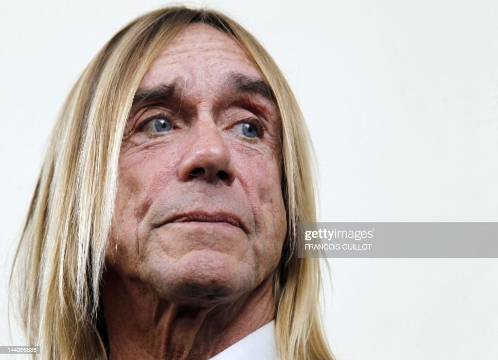 US singer Iggy Pop looks on during a press conference to present his new album 'Après', on May 9, 2012 in Paris. 'Après' ('After' in French) is Iggy Pop's 16th record, with covers of international and French standards (such as Frank Sinatra, The Beatles, Edith Piaf, Serge Gainsbourg, Georges Brassens, Henri Salvador), exclusively on sale on the French online retailer website vente-privee.com, specialising in selling brand overstock and organizing events-based sales.