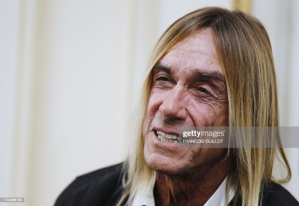 US singer Iggy Pop reacts during a press conference to present his new album 'Après', on May 9, 2012 in Paris. 'Après' ('After' in French) is Iggy Pop's 16th record, with covers of international and French standards (such as Frank Sinatra, The Beatles, Edith Piaf, Serge Gainsbourg, Georges Brassens, Henri Salvador), exclusively on sale on the French online retailer website vente-privee.com, specialising in selling brand overstock and organizing events-based sales.