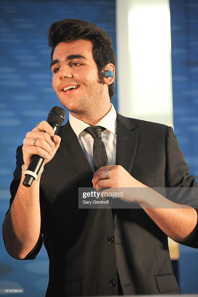Singer Ignazio Boschetto of ll Volo performs at jetBlue Terminal 5 at JFK Airport on December 4, 2012 in New York City.