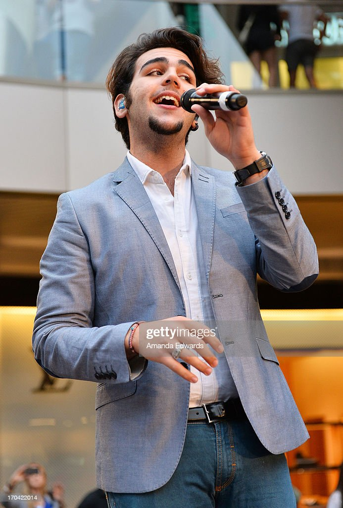 Singer <a gi-track='captionPersonalityLinkClicked' href=/galleries/search?phrase=Ignazio+Boschetto&family=editorial&specificpeople=5945023 ng-click='$event.stopPropagation()'>Ignazio Boschetto</a> of the group Il Volo performs onstage before signing copies of their new album 'We Are Love' at Santa Monica Place on June 12, 2013 in Santa Monica, California.