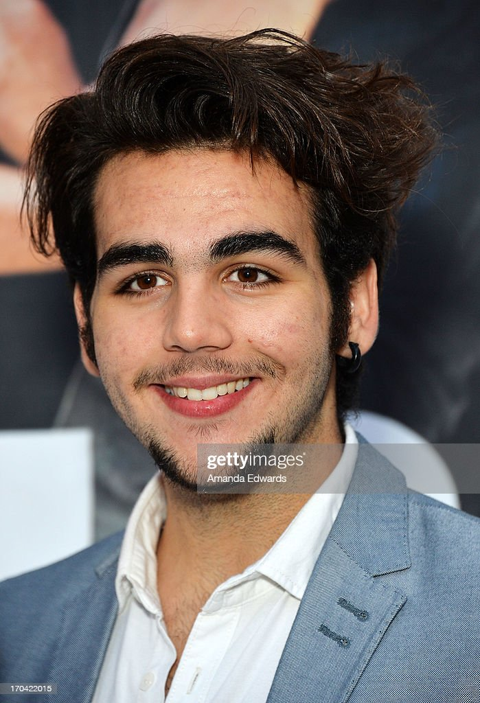 Singer Ignazio Boschetto of the group Il Volo poses before signing copies of their new album 'We Are Love' at Santa Monica Place on June 12, 2013 in Santa Monica, California.