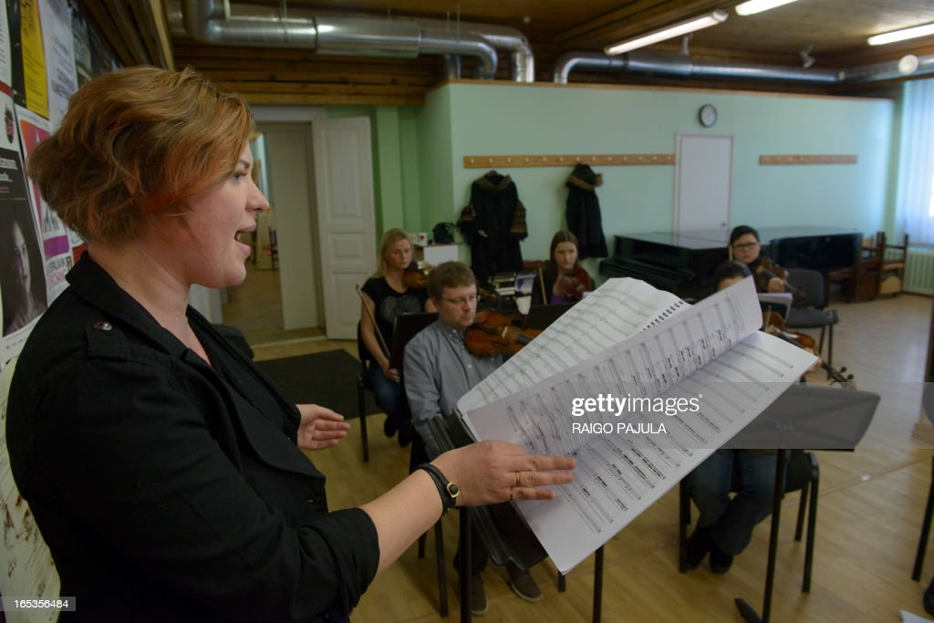 Singer Iris Oja (L) performs with members of the Tallinn Chamber Orchestra during a rehearsal of the opera 'Nostra Culpa' on April 3, 2013 in Tallinn, Estonia. US composer Eugene Birman turned into an opera a Twitter feud between the Estonian President Toomas Hendrik Ilves and New York Times columnist Paul Krugman who questioned the impact of Estonia's austerity measures. The short opera in two movements and using two voices will be first performed during Tallinn Music Week on April 7, Birman, who moved from Riga to the US at age of six, told AFP.