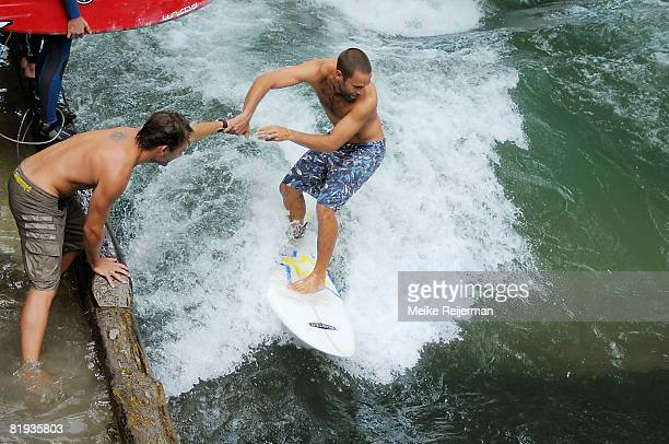Singer Jack Johnson is seen surfing the famous 'Eisbach' near the discotheque P1 on July 11 2008 in Munich Germany The hawaian singer and former...