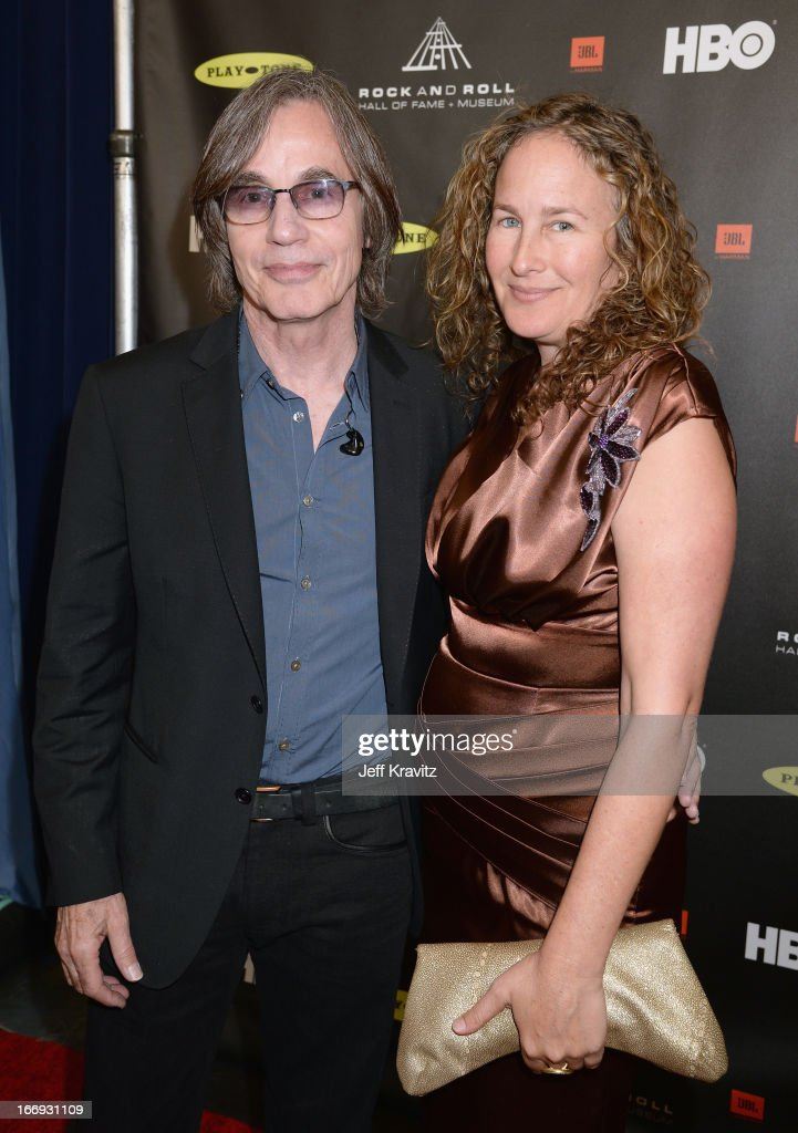 Singer <a gi-track='captionPersonalityLinkClicked' href=/galleries/search?phrase=Jackson+Browne&family=editorial&specificpeople=210572 ng-click='$event.stopPropagation()'>Jackson Browne</a> (L) and artist Dianna Cohe arrive at the 28th Annual Rock and Roll Hall of Fame Induction Ceremony at Nokia Theatre L.A. Live on April 18, 2013 in Los Angeles, California.