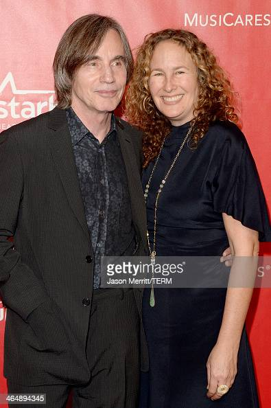 Singer Jackson Browne and artist Dianna Cohen attend The 2014 MusiCares Person Of The Year Gala Honoring Carole King at Los Angeles Convention Center...
