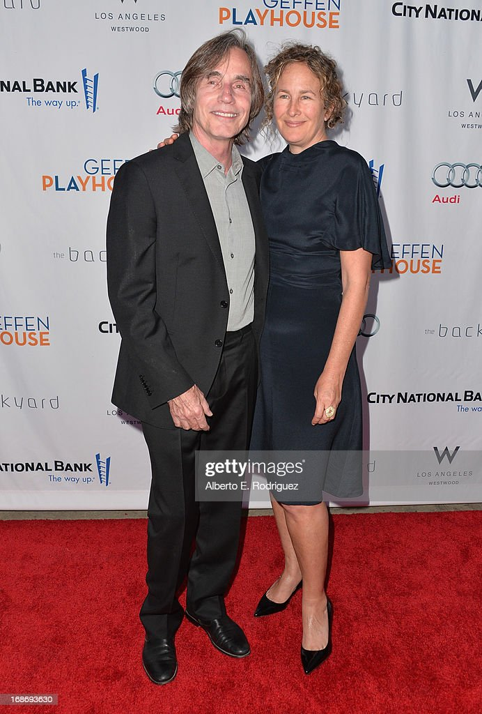 Singer <a gi-track='captionPersonalityLinkClicked' href=/galleries/search?phrase=Jackson+Browne&family=editorial&specificpeople=210572 ng-click='$event.stopPropagation()'>Jackson Browne</a> and Dianna Cohen arrive to The Geffen Playhouse's Annual 'Backstage at the Geffen' Gala at Geffen Playhouse on May 13, 2013 in Los Angeles, California.