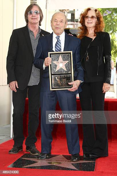 Singer Jackson Browne music executive Joe Smith and singer Bonnie Raitt attend a ceremony honoring music executive Joe Smith wtih a star on The...