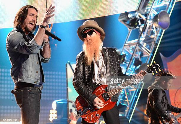 Singer Jake Owen and musician Billy Gibbons perform onstage during the American Country Awards 2013 at the Mandalay Bay Events Center on December 10...